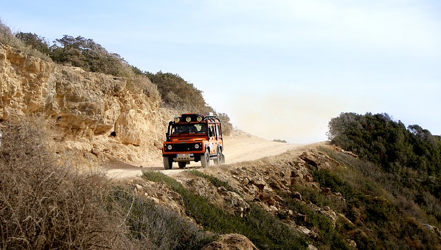 A truck traveling down a dirt road